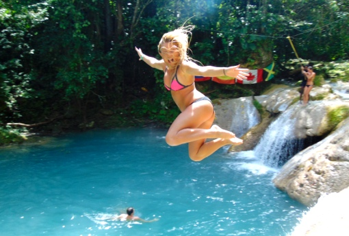 Woman cliff jump at the Ocho Rios Blue Hole
